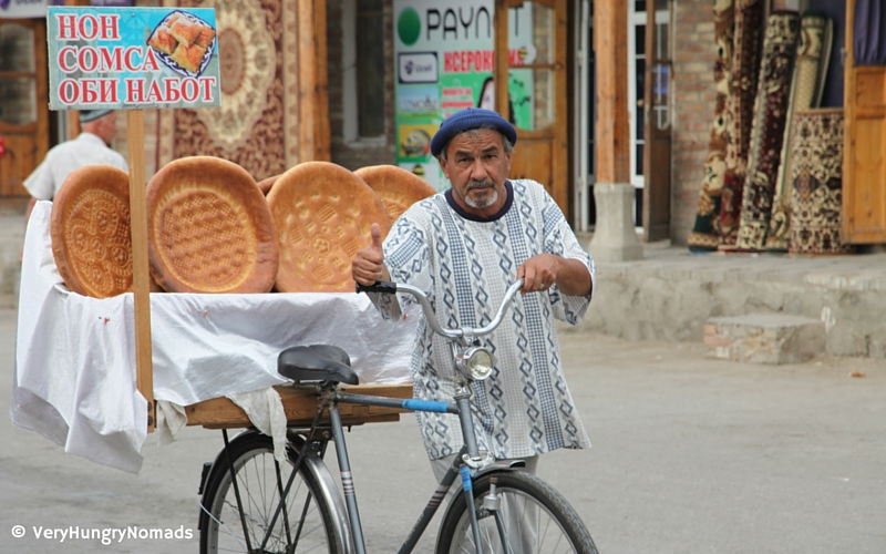 Bread seller on the streets of Bukhara, Uzbekistan - People we meet travelling