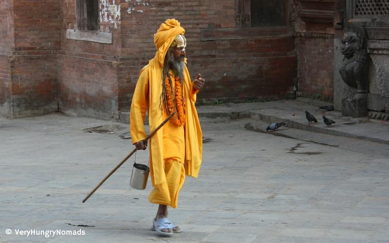 Man wondering the streets of Kathmandu - People we meet travelling