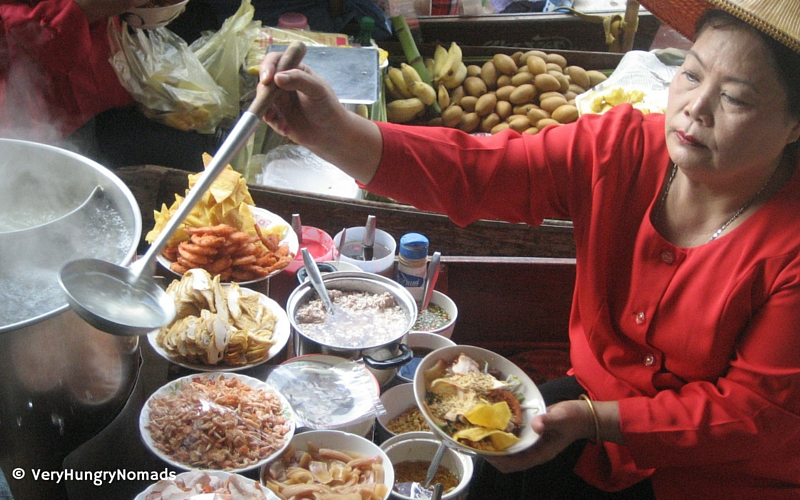 Thai food vendor at the floating market near Bangkok - People we meet travelling