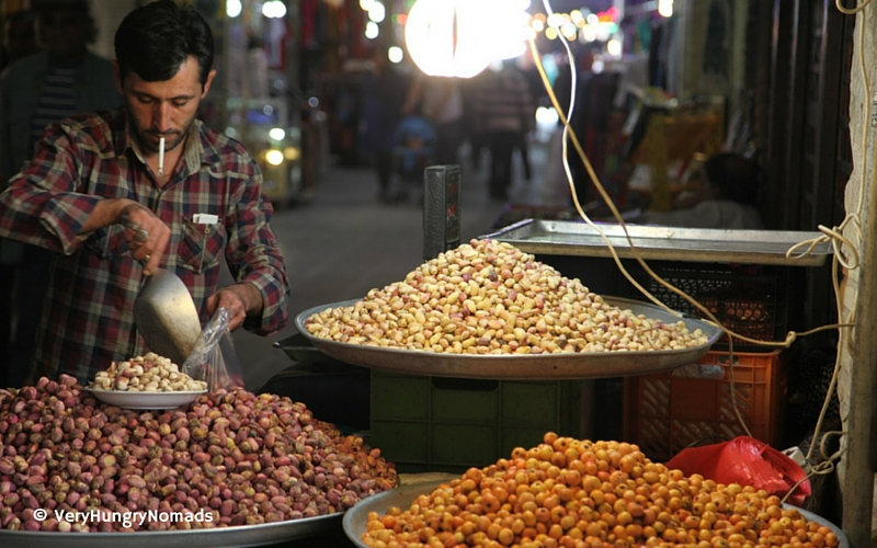 Market vendor selling pistachios in Isfahan, Iran - People we meet travelling