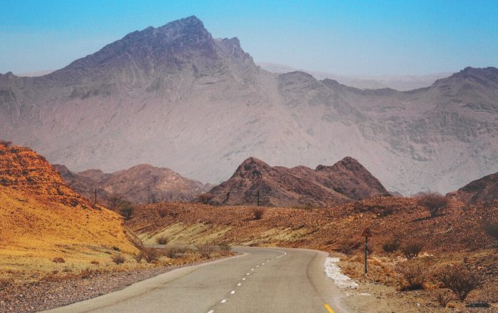 10 reasons why you should visit oman - roads and mountains